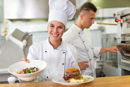Photo for Two smiling chefs in kitchen - Royalty Free Image