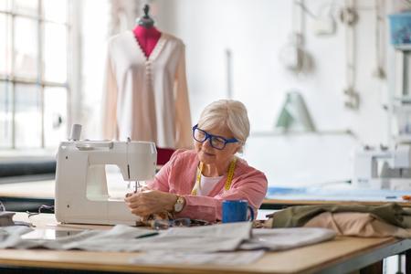 Photo for Confident senior fashion designer in her workshop - Royalty Free Image