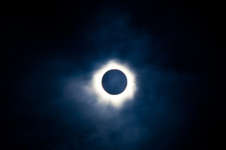 Total solar eclipse with the moon obscuring the disc of the sun so that only the corona is visible as a bright ring