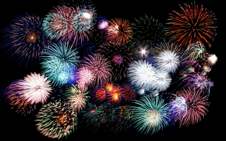 Colorful festive fireworks  sparklers  salute and petards explosions isolated over black night sky background