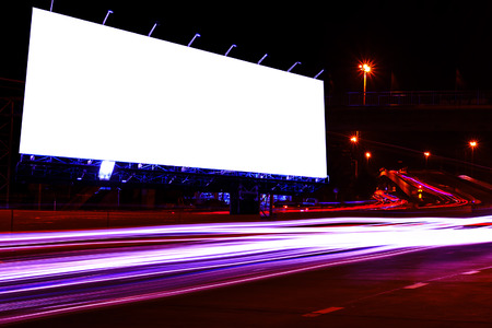 Foto de blank billboard at night time for advertisement city street night light , colored filter. - Imagen libre de derechos