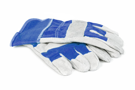 Foto de Pair of blue protective work gloves isolated on a white background. - Imagen libre de derechos