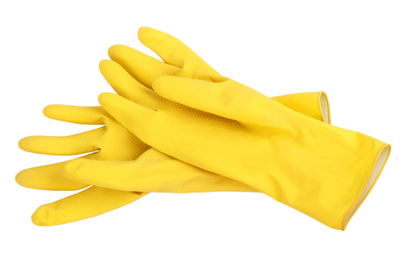 Foto de Pair of yellow rubber cleaning gloves isolated on a white background. - Imagen libre de derechos