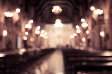Foto de blurred photo of church interior in vintage filter for background - Imagen libre de derechos