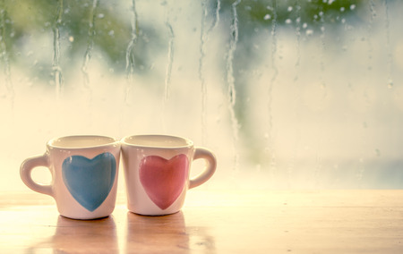 Photo for two lovely glass on rainy day window background  in vintage color tone - Royalty Free Image