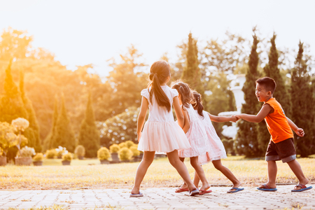 Photo pour Asian children holding hand and walking together in the park in vintage color tone - image libre de droit