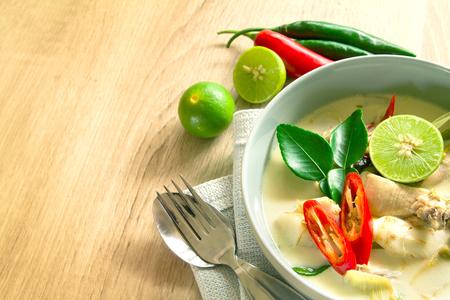 Foto de Spicy creamy coconut soup with chicken , Thai food called Tom Kha Gai on wooden table - Imagen libre de derechos