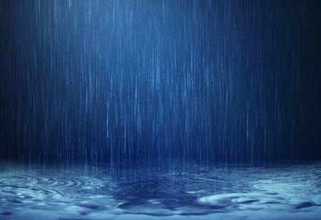Foto de The rain water drop falling to the floor in rainy season - Imagen libre de derechos