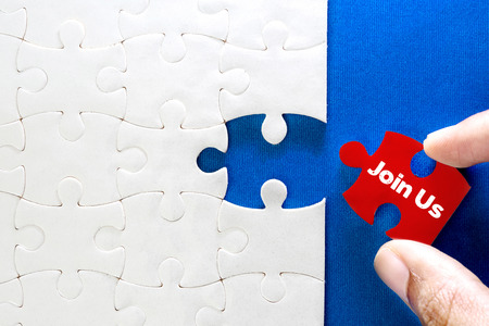 Photo for Close up piece of white jigsaw puzzle with Join Us text , concept of business challenge success completion with teamwork - Royalty Free Image