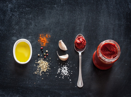 Photo for Pizza topping sauce ingredients or recipe on black background.  Background with free text space. - Royalty Free Image
