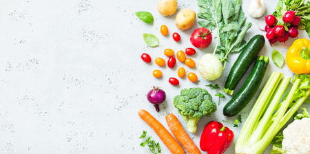 Photo for Kitchen - fresh colorful organic vegetables captured from above (top view, flat lay). Grey stone worktop as background. Layout with free text (copy) space. - Royalty Free Image