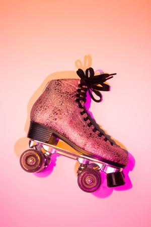 Foto de Retro pink glittery roller skate - poster layout design. Colorful (multicolor tonal transitions) background with free text (copy) space. - Imagen libre de derechos
