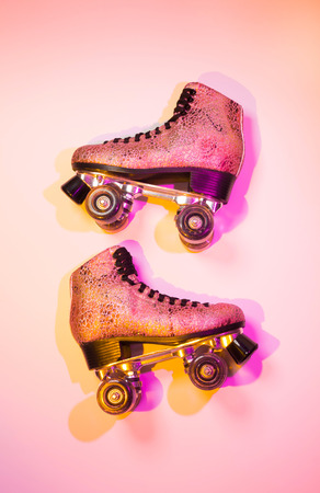 Foto de Retro pink glittery roller skates - poster layout design, disco style. Colorful (multicolor tonal transitions) background with free text (copy) space. - Imagen libre de derechos