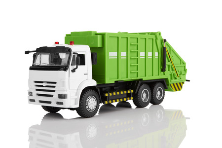 Foto de Garbage truck toy isolated on a white background - Imagen libre de derechos