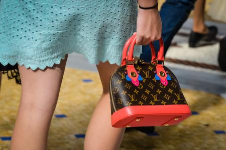 Photo pour Milan, Italy - September 24, 2017:  Louis Vuitton store in Milan. Fashion week Louis Vuitton shopping - image libre de droit