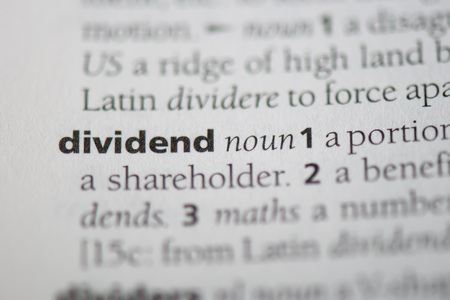 Photo for dividend word in a dictionary. dividend concept - Royalty Free Image