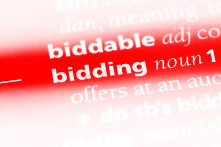Foto de bidding word in a dictionary. bidding concept. - Imagen libre de derechos