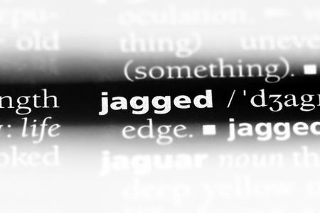 Foto de jagged word in a dictionary. jagged concept. - Imagen libre de derechos