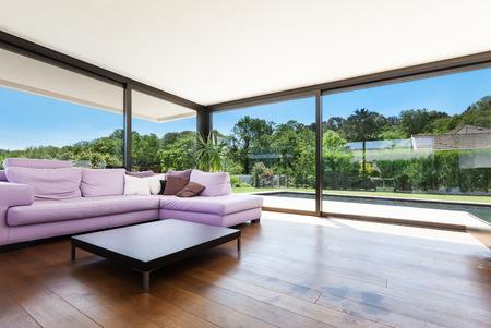 Modern villa, interior, wide living room with divan
