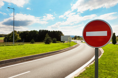 Photo pour road with road sign prohibiting - image libre de droit