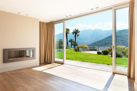 Foto de Architecture, empty living room with large windows - Imagen libre de derechos