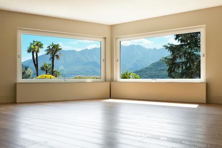 Foto de empty living room with large windows - Imagen libre de derechos