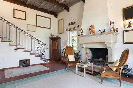 Foto de interior of old house with classic furniture, living room with fireplace - Imagen libre de derechos