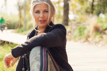 Foto de Fifty year old woman in outdoors - Imagen libre de derechos