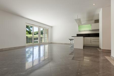 Photo pour Interior of empty apartment, wide living with kitchen, marble floor - image libre de droit