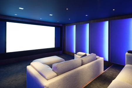 Foto de Home theater, luxury interior, comfortable divan and big screen - Imagen libre de derechos