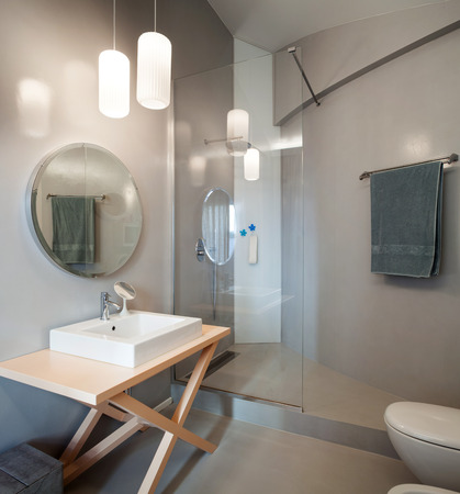 Photo for Luxury apartment, modern bathroom with round mirror - Royalty Free Image