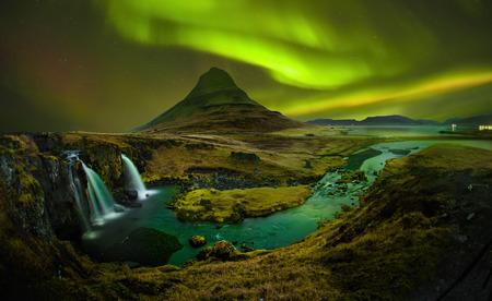 Photo for Aurora at Kirkjufell and Waterfall Kirkjufellsfoss, Landmark of Iceland. Kirkjufell Church mountain is mountain on the north coast of Iceland's Snfellsnes peninsula. - Royalty Free Image