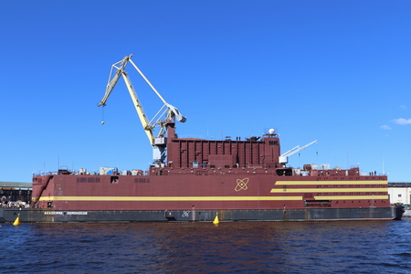 Photo for Saint Petersburg, RUSSIA - MAY 03, 2017: The world's first floating nuclear power block Akademik Lomonosov at the quay wall of the Baltic shipyard - Royalty Free Image
