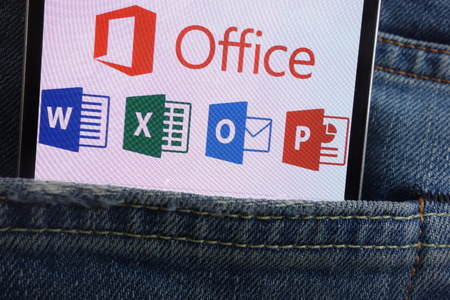 Photo pour KONSKIE, POLAND - JUNE 01, 2018: Microsoft Office logo displayed on smartphone hidden in jeans pocket - image libre de droit