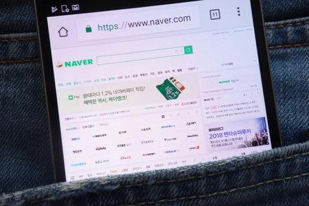Photo pour KONSKIE, POLAND - JUNE 02, 2018: Naver website displayed on smartphone hidden in jeans pocket - image libre de droit