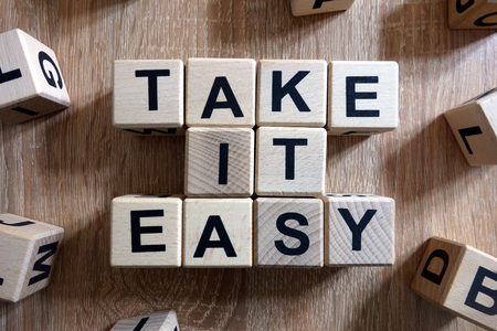 Photo pour Take it easy text from wooden blocks on desk - image libre de droit