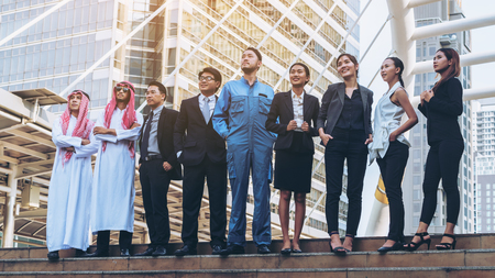 Photo for Multicultural business people group including Arabic, East Asian, Latin American standing in modern city. Concept of multi ethnic, multiracial business team. - Royalty Free Image