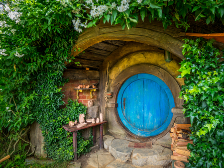 Photo for Matamata, New Zealand - Dec 11, 2016: Hobbiton movie set created for filming The Lord of the Rings and The Hobbit movies in North Island of New Zealand. It is opened for tourist who visit New Zealand. - Royalty Free Image
