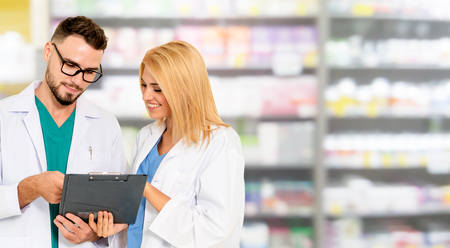 Foto de Pharmacist working with another pharmacist in the pharmacy. Healthcare and medical service. - Imagen libre de derechos