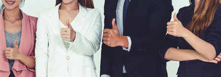 Businesswomen and businessman standing in row in office. Corporate business and teamwork concept.