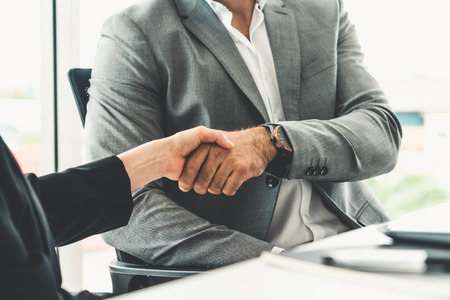 Photo for Businessman executive handshake with businesswoman worker in modern workplace office. People corporate business deals concept. - Royalty Free Image