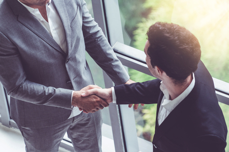 Photo for Businessman handshake with another businessman partner in modern workplace office. People corporate business deals concept. - Royalty Free Image