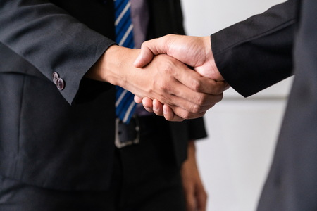Photo for Business people agreement concept. Businessman do handshake with another businessman in the office meeting room. - Royalty Free Image