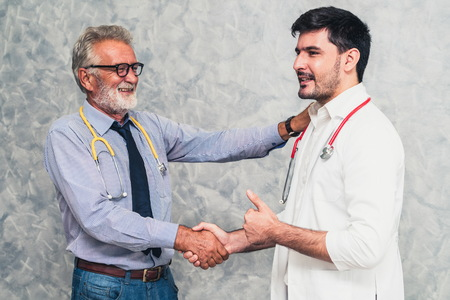 Photo for Doctor in hospital handshake with another doctor. Healthcare people teamwork and medical staff service concept. - Royalty Free Image