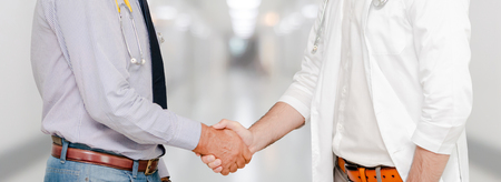 Photo for Doctor in hospital handshake with another doctor. Healthcare people teamwork and medical service concept. - Royalty Free Image