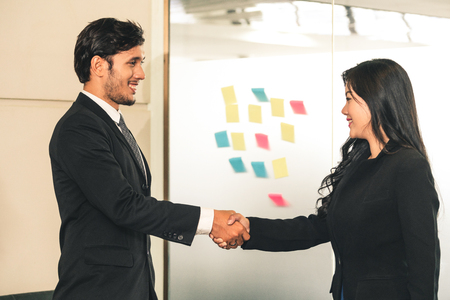 Photo for Business people agreement concept. Businessman and Asian businesswoman do handshake in the office. - Royalty Free Image