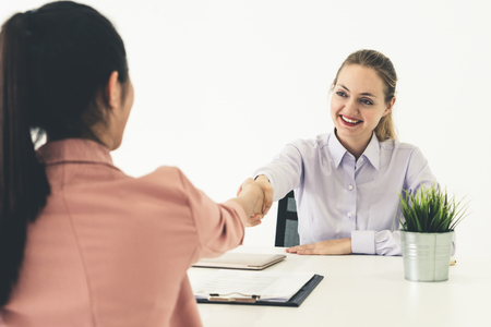 Photo for Two young business women in meeting at office table for job application and business agreement. Recruitment and human resources concept. - Royalty Free Image