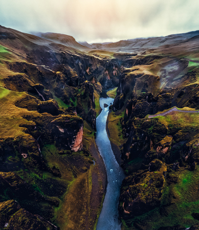 Photo for Unique landscape of Fjadrargljufur in Iceland. Top tourism destination. Fjadrargljufur Canyon is a massive canyon about 100 meters deep and about 2 kilometers long, located in South East of Iceland. - Royalty Free Image