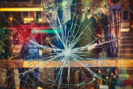 Foto de Broken shop window with color background - Imagen libre de derechos