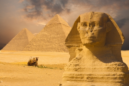 Photo for The Great Sphinx's face with a set of pyramids in the background and a beautiful purple sunset sky day in Giza, Cairo, Egypt - Royalty Free Image